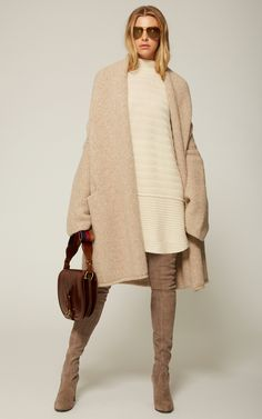 e3e3adfe6617 This   Lauren Manoogian   Askew Pullover Sweater features variegated  ribbing, a high neckline, and mini length hem.
