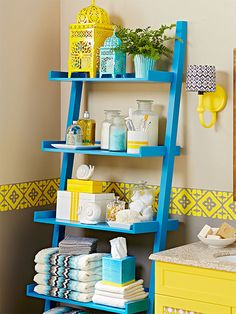 Uniform shelving units can push out into a small room, overpowering it and making it feel smaller than it really is. Instead, look for pieces that stair-step back the depth of the shelves, getting narrower at the top and lightening a room's look and feel.