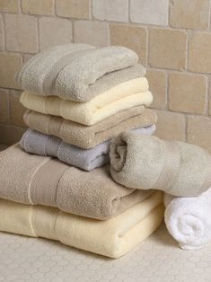How to make your old towels look brand new...  First: old towels in the washer with hot water and 1 cup vinegar.  Then: as the cycle is done, was the towels again with hot water and 1/2 cup of baking soda.  Last: once you're done stick the towels in the drier.  Be ready to enjoy fluffy and fresh towels ! by Rob Ward