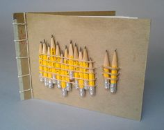 """Pencil Bunch"", side stab binding, found and repurposed materials"