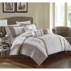 Simple yet stylish, the Chic Home Adam Comforter Set is the perfect way to update your bedroom decor. The bold color block design with floral design coordinates beautifully with matching decorative pillows and sheets for a complete look. Modern Comforter Sets, Twin Comforter Sets, King Comforter, Duvet Sets, Adjustable Bed Frame, Bed Linen Design, Bed In A Bag, King Pillows, Comforters