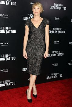 Robin Wright Cocktail Dress - Robin Wright wore a deep-v dress with a metallic sheen for the 'Girl With the Dragon Tatto' NY premiere.