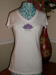 Lotus Life Designs...this if the front view of all the white, short sleeves we now offer.    www.LotusLifeDesigns.com