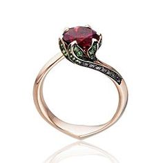 Multi-award-winning jeweller,Tomasz Donocik aims to challenge preconceptions of self-adornment. This exquisite ring inspired by the paradox of the natural world fuses the dark side of beauty with the delicate nature of fine jewelry. Crafted from 18k rose gold and set with black diamonds, tsavorites with a large center rubellite stone, this Lilly Pad Ring is a contemporary heirloom that will be passed on to the next generation.