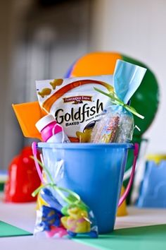 Cute favors for pool/swimming party- I did this for my munchkins birthday one year (pool party) and I added the guests names on the pail with a paint marker, and added a towel in each one too :)