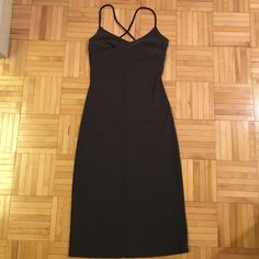 Body hugging dress 94 poly, 6 spandex. Tea length with black spaghetti straps that cross in the back. 39 inches shoulder to hem. Size says small but fits more like xs. Evolution Dresses Midi