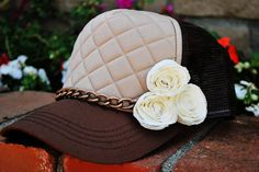Brown quilted trucker hat with flowers and chain. www.morethanahat.com  More Than A Hat