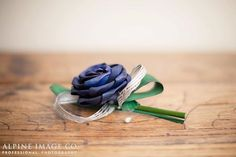 Stunning buttohole with a blue flax rose, silver hapene ribbon and green flax foliage. By Artiflax Wedding Cake Toppers, Wedding Cakes, New Zealand Flax, Flax Flowers, Corsages, Corporate Gifts, Buttonholes, Wedding Bouquets, Ribbon