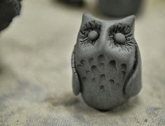 A tiny owl made from clay looks on!