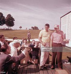 Actor and singer Dean Martin plays golf, circa 1955.