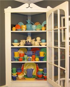 A great cabinet of colorful vintage HLC dishes - including Fiesta©, Riviera, World's Fair pieces, and more.