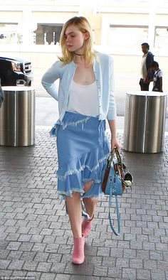 Elle Fanning wearing a blue ruffled skirt with an asymmetrical hem and pink Chanel booties as she arrived at LAX on Saturday, February 2016
