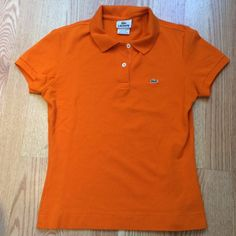 Lacoste polo shirt Size 40. Fits me like a small. EUC Lacoste Tops