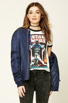 A cotton blend ringer knit tee featuring a front Star Wars™ graphic, a round neckline, contrast trim, and short sleeves.