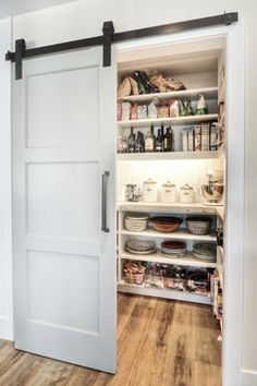 Not a fan of the sliding barn door trend but I love the handle on the pantry door -- would like to get one from IKEA for our [new] pantry door