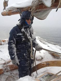 winter sailing... Visibilty must be zero... Determination and love of your vessell sails through the chilliest weather...