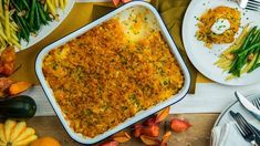 A cheesy casserole that's perfect for any feast! Side Dish Recipes, Side Dishes, Rice Recipes, Thanksgiving Recipes, Vegetarian Thanksgiving, Potato Casserole, Vegetarian Cooking, Tasty Dishes, Good Food