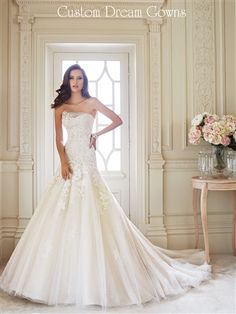 Elsa Y21430 By Sophia Tolli Fall 2014 is a Romantic Lace & Tulle Fit & Flare A-Line Gown with Draped Illusion Dipped Strapless Neckline with Flowers and Crystals, Fitted Lace Bodice to Hips with Diamond Tulle Underneath into Flowing A-Line Skirt, Chapel