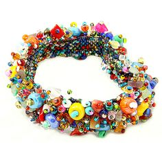 @Overstock - Bracelet Capullo Multicolor has a base of handwoven Czech glass beads that is richly fringed with an assortment of Czech glass beads and coral and crystal chips. Fits comfortably and securely with a hidden magnetic clasp.http://www.overstock.com/Worldstock-Fair-Trade/Coral-and-Crystal-Capullo-Multicolored-Bead-Bracelet-Guatemala/6504753/product.html?CID=214117 $21.99