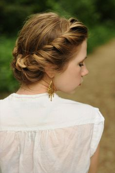 Hair in two parts: left side - twist and coil in the middle; right side: twist, wrap around first bun & pin.