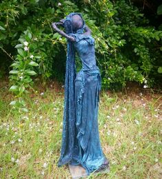 Paverpol lady sculpture using  recycled T-shirt material, wire, foil and and old tile.