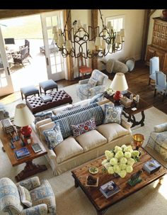 seating arrangement - tables at either end of back to back sofas. backless stools to open doors