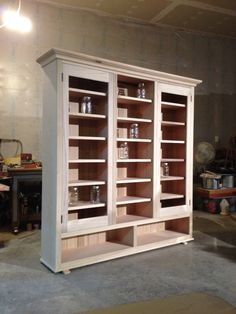 Custom designed canning storage. Holds 412 quarts. Distressed finish to be provided by owner.