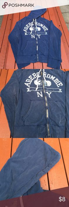 Abercrombie & Fitch NY Mens medium. I tried showing the flaws in pictures. Small black spots and a hole in the hood. Color is starting to fade a bit. Priced as necessary. Zip up. Navy with cream distressed logo. Abercrombie & Fitch Tops Sweatshirts & Hoodies
