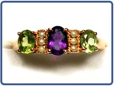 """Suffragette"" ring with amethyst, peridots and seed pearls."