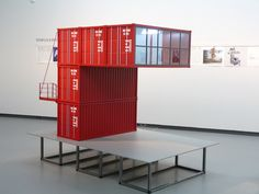 a contemporary compilation of proposed and realized projects configured from shipping containers are featured in this inclusive exhibition.