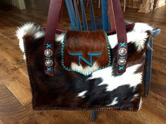 The cowhide Buckaroo Diaper Tote with the customers brand in turquoise suede. From gowestdesigns.us