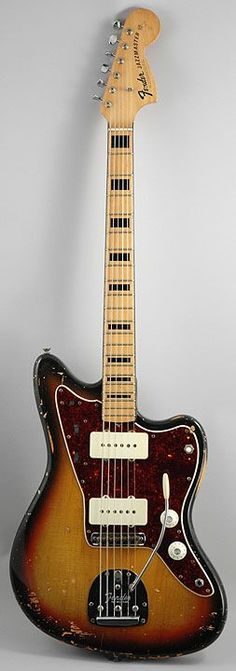 70s Fender Jazzmaster, with black binding on the neck and black block inlays.
