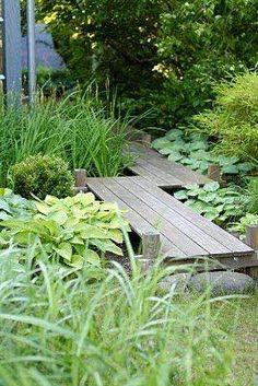 this decking walkway which would work beautifully over a water feature. Bog Garden, Garden Steps, Dream Garden, Back Gardens, Outdoor Gardens, Jungle Gardens, Wooden Garden, Wooden Path, Water Features In The Garden