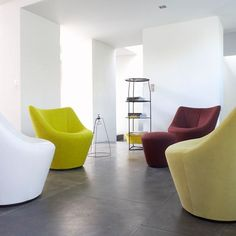 ANDA; Pierre Paulin. Anda envelopes and supports the body perfectly. Anda outstrips the archetype of the historical 'fauteuil crapaud' (squat armchair) by offering a totally new shape - offered, for optimum comfort, in both low and high-backed version, complemented by a footstool.
