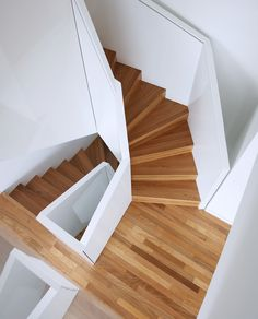 Spiral geometrical staircase. Lacquered MDF boards. By edit! architects