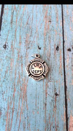 Fire department symbol charm 3D antique by KimsFancyFindings