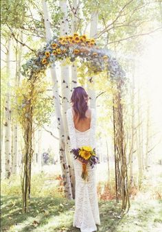 Sunshine and flowers and trees!! what a casual style for a bride.