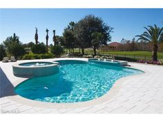 5876 Sunnyslope, Naples, FL 34119 | Large pool and outdoor entertaining area make certain that all of the backyard pool parties start and end at your house.  Quail West