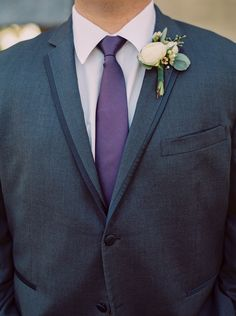 Groom Boutonniere with white ranunculus, wax flower and eucalyptus. Photo by Jessica Gold Photography