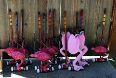 "dark pink flamingos at a local store. They only had 9 of them so I made 3 more out of 1/4"" plywood. I then purchased soft nerf type balls so they would be easier to hit with the mallets. The girls were so excited when they walked out to the patio and the 12 mallets were waiting for them"