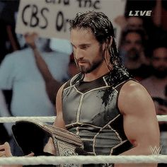 Seth Rollins kissing his WWE World Heavyweight Championship