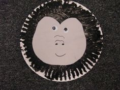 gorilla paper plate craft for preschoolers. Add a tail and make it look like a lower case g.