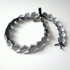 Mia Kwon - likeflower #02 (2013); Mont-Blanc porcelain, Bohemian glass beads, silk thread, metal ring