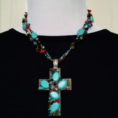 """Turquoise & silver Cross multi beaded necklace This statement cross necklace is far more beautiful in person than any picture could attempt to capture! Bright & bold & colorful, this piece is sure to be the star piece of your collection! Featuring a 3"""" adjustable extender chain at the silver clasp & a breathtaking approx. 3""""x2"""" Cross pendant, colors of turquoise, red, green, tan, black, gold & silver, you need to get this gorgeous necklace today before it's gone!!! Don't forget to BUNDLE…"""