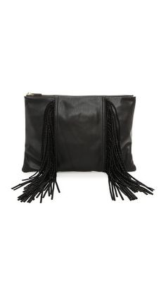 Crystal trimmed fringe hangs from this soft, faux leather clutch. The top zip opens to a lined interior with 3 pockets. Dust bag included. Fabric: Faux leather.