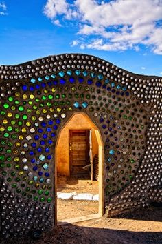 Beautiful Door at Earthship house near Taos, New Mexico, made from recycled materials. Bottle House, Bottle Wall, Earthship Home, Earthship Biotecture, Parc A Theme, Land Of Enchantment, Jolie Photo, Sustainable Architecture, Gardens