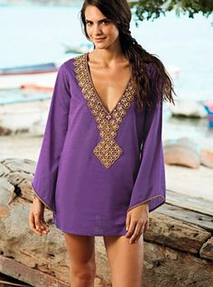 This cheerful purple beach cover-up is perfect for those days when you're feeling down; it will definitely make you smile. Wear it in this summer time and be ready to have some wild fun! - Price $173