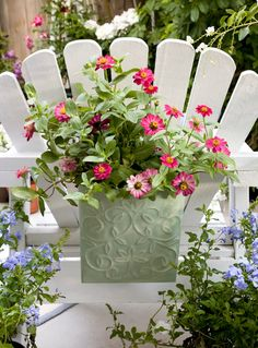 Make a hidden water reservoir for pots in the garden.When you pot up your flowers dangle a few 'wicks' (mop strings) out of the drainage holes. The wicks should be placed a few inches into the potting mix in your planter..