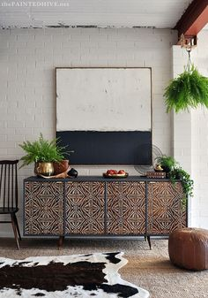 Use paint to fix up a dilapidated sideboard.