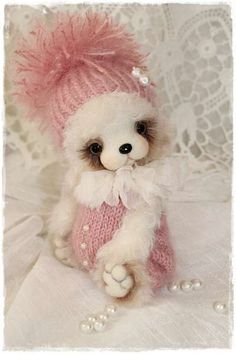 """Primroses By Sadovskaya Tatiana -  Bears are made of mohair. thick and very soft fur snow white. filled. wool granulate. legs can bend. cap pants knitting mohair yarn of class """"luxury"""". decorated with beads. chiffon collar. The price is for one bear. when ordering specify exactly what you liked. I hope you enjoy ..."""